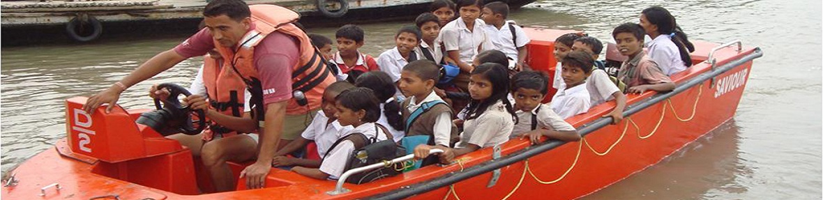 National Disaster Response Force(NDRF) shifting school children to safer places during Cyclone Aila.