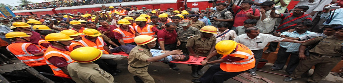 Rescue workers take out an injured man out of the Uttarbanga Express at the accident site at Sainthia station in West Bengal.